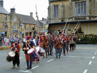 Colonel J Pickering's regiment of the Sealed Knot parade in front of St Edward's Hall Stow on the Wold