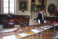 A man with some of the English Civil War weaponry from Stow on the Wold's collection of Civil War memorabilia