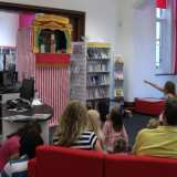 Professor Collywobbles' Punch & Judy show entertaining children in the Library
