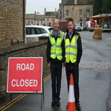 Danial Birch and Matt Totham manning the road entry as the festival stalls get set up