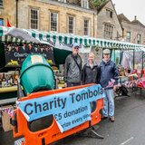Leone and Ron McAlpine plus Stephen Gurmin on the Giant Charity Tombola stall